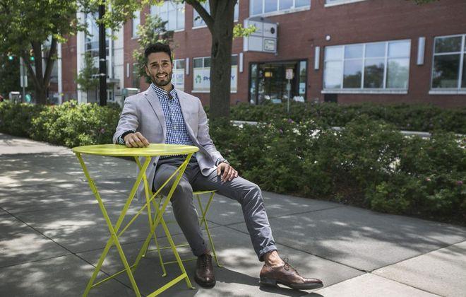 Brian J. Straka, director of Portfolio Recruitment & Selection at 43North, takes a seat outside his office building. (Shuran Huang/Buffalo News)