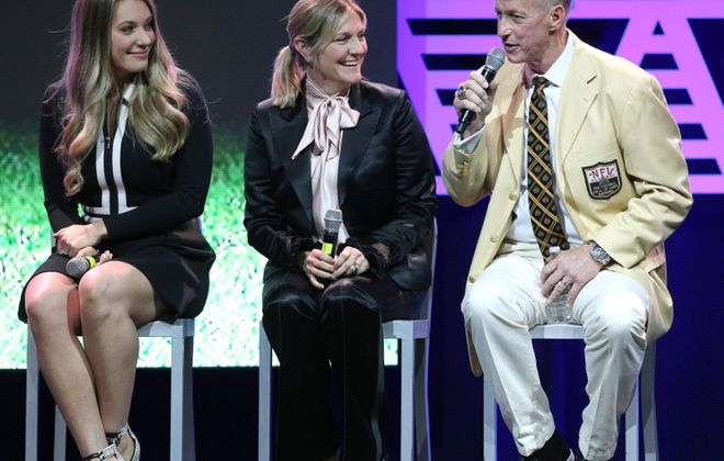 Pro Football Hall of Fame quarterback Jim Kelly (right) speaks during the Best of Stark 2018 Gala at the Canton Memorial Civic Center. With him is his wife Jill Kelly (center) and their daughter Erin Kelly-Bean (left).  (CantonRep.com / Scott Heckel)