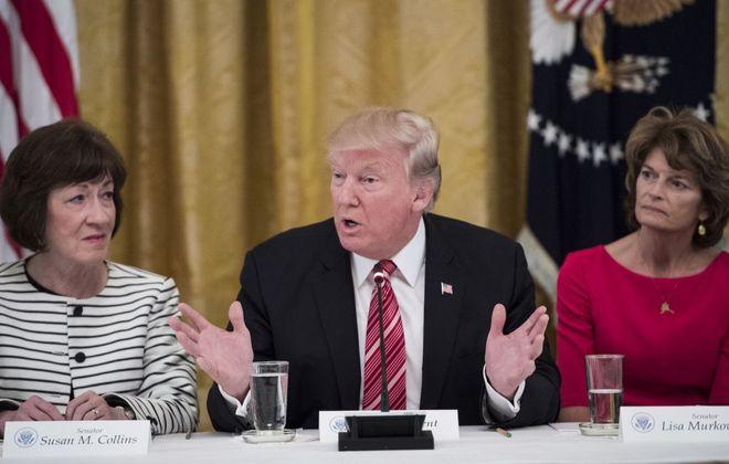 Sen. Susan Collins of Maine and Sen. Lisa Murkowski of Alaska meet with President Trump at the White House last year. (Jabin Botsford/The Washington Post via Getty Images)