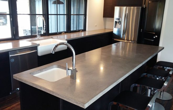 In the kitchen, concrete countertops have become a popular alternative to stone, (Concrete Innovations)