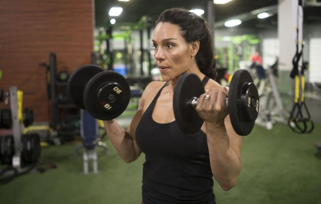 Amy Bueme, owner of Catalyst Fitness, works out at the gym on French Road in Depew in November. The company will convert the former Dick's Sporting Goods off Maple Road in Amherst into its seventh location. (Derek Gee/Buffalo News file photo)