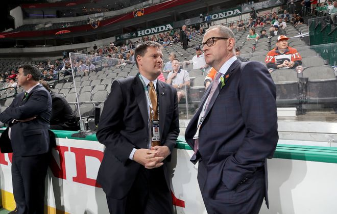 Sabres GM Jason Botterill, left, talks to Calgary's Brad Treliving at the NHL Draft in June 2018. (Getty Images file photo)
