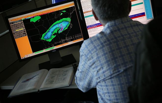 A forecaster analyzes data at the NOAA Center for Weather and Climate Prediction in College Park, Md. (Getty Images file photo)