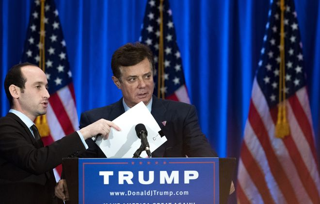 A June 2016 file photo shows then-Trump Campaign chairman Paul Manafort checking the podium before a speech by Donald Trump. (Getty Images)