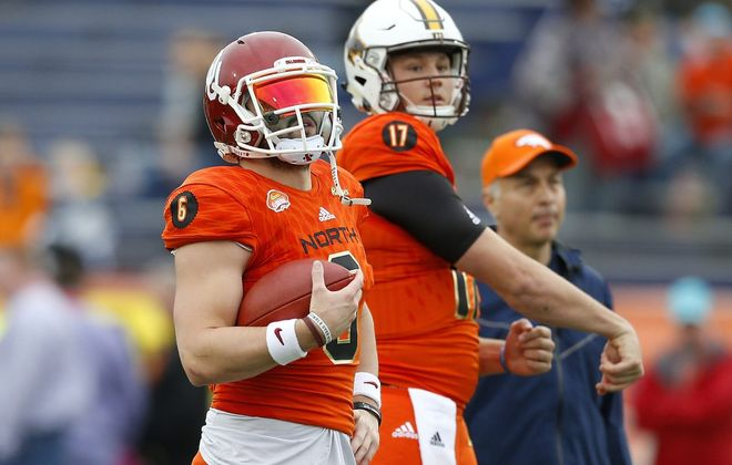 Baker Mayfield, left, and Josh Allen warm up before the Reese's Senior Bowl at Ladd-Peebles Stadium on Jan. 27, 2018, in Mobile, Ala.  (Photo by Jonathan Bachman/Getty Images)