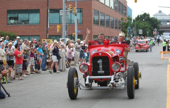 Howard and Douglas Sharp, a father-son duo from Fairport, N.Y., roll through Buffalo during the 2012 Great Race in a 1911 Vehlie. (News file photo)