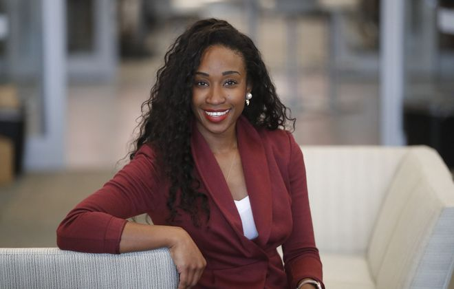 """We're creating an international movement where women are no longer ashamed of their femininity,"" says Davielle Jackson, in her workspace at the Innovation Hub on the Buffalo Niagara Medical Campus. (Mark Mulville/Buffalo News)"