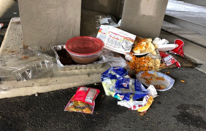 Some of the trash left behind Saturday morning in a parking lot near Washington and Exchange streets. (T.J. Pignataro/Buffalo News)