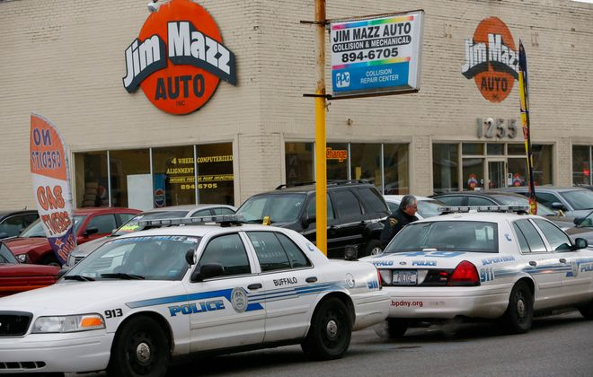 Buffalo Police vehicles block the street as FBI agents execute a search warrant at Jim Mazz Auto on Bailey Avenue in the city's Lovejoy neighborhood, in 2012.  (Derek Gee/Buffalo News file photo)