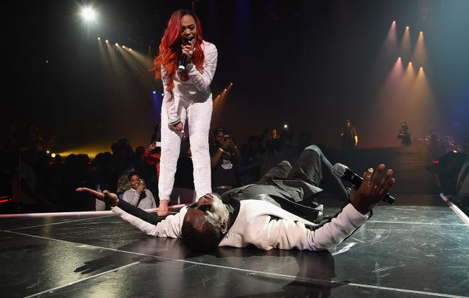 """Faith Evans (seen here performing with Sean """"Diddy"""" Combs aka Puff Daddy) will headline the Summer Soul Festival at Canalside on June 30.  (Photo by Jamie McCarthy/Getty Images)"""