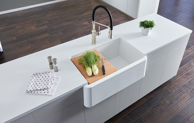 Farmhouse sinks are deep and extend beyond the cabinet fronts. (Blanco)