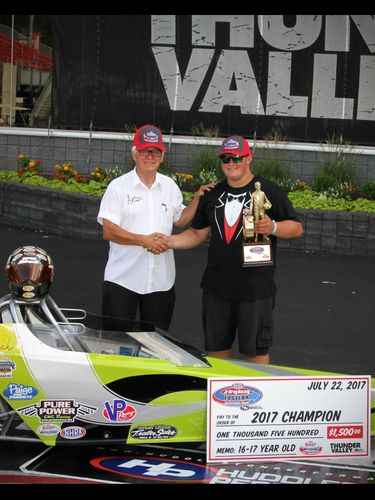 Mike Bos, left, congratulates the winner of the 2017 Junior National Championships at Bristol Dragway.