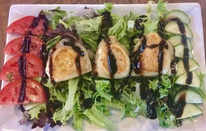 The Ru's Pierogi Salad is one of the lighter options at the Original Warehouse. Your choice of either goat cheese or banana pepper filling under a balsamic glaze atop mixed greens alongside tomatoes and cucumbers. (Phil Wagner/Special to The News)
