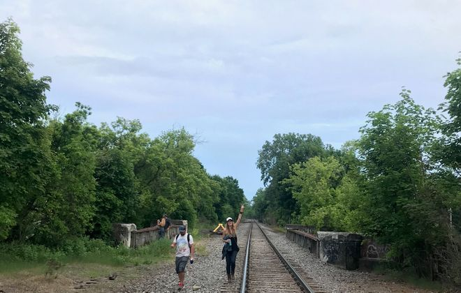 An ex-pat's return: Jennifer Brazill (r) walks the railroad tracks in East Aurora, not far from the site that will host the Borderland Music & Arts Festival, which she helped to curate. (Photo courtesy of Zach Keller)