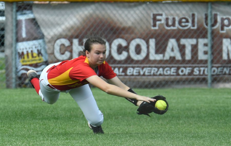 Olean outfielder Holly Vincent misses a catch during the Class B semifinal against Icahbod Crane (Jenn March, Special to the Buffalo News)