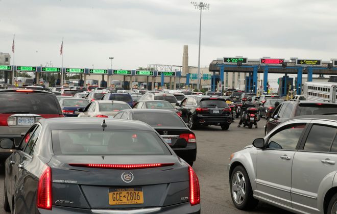 Lines of traffic wait to enter the USA from Canada at  the Peace Bridge in Buffalo in this file photo. (John Hickey/Buffalo News)
