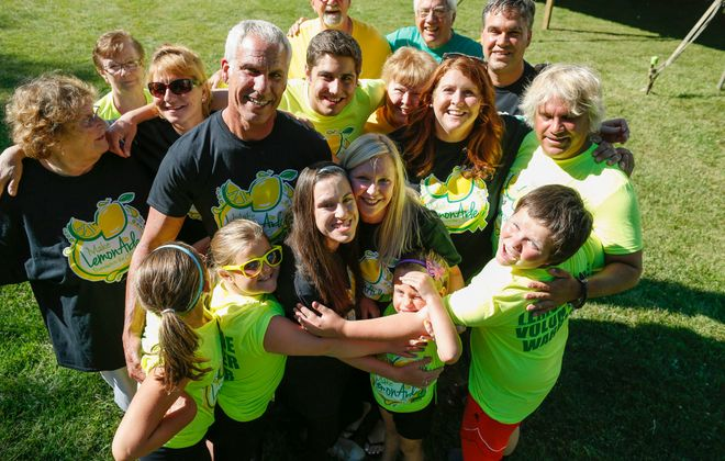 Lauren Walier, center, of suburban Atlanta, is the inspiration for the Make Lemon Aide Foundation for CP. She and her loved ones in the region will host the Lemon Twist Gala II on Nov. 16 at Asbury Hall, 341 Delaware Ave., to benefit those with cerebral palsy, as well as physical therapists who help treat it. (Derek Gee/News file photo)