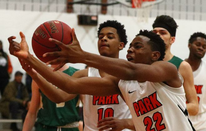 Park's John Orogun rebounds the ball away from Timon's Tahron Goudelock in the first half at the Park School in Amherst on Friday, Feb. 2, 2018. (James P. McCoy/Buffalo News)
