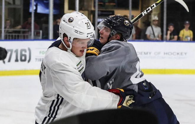 Casey Mittelstadt (white) and Matej Pekar (gray) got physical several times during Saturday's 3-on-3 tournament in HarborCenter. (James P. McCoy/Buffalo News)