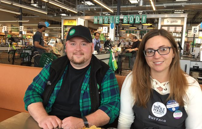Rob O'Connor, produce team leader at Whole Foods Market in Amherst, and Brittany Wilson, marketing and community liaison at the Sheridan Drive store, have teamed up to offer free cooking demonstrations, and tastings, once a month. (Scott Scanlon/Buffalo News)