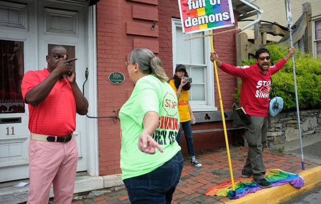 Kim Pettus, left, of Richmond argues with Dianna Orea as Edgar Orea protests in front of the Red Hen in Lexington, Va., on Tuesday, June 26. (Norm Shafer/The Washington Post)