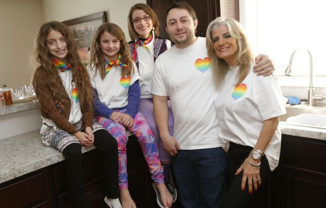 "Will Mason was inspired to write ""The Boy with the Rainbow Heart,"" an LGBT book for children, by his own family's experiences. Here he is at his Cheektowaga home with his sister Jessica Lowell Mason, center, and mother Susan Pazzaglia. At left are Jessica's daughters Darah, 10, and Elanah, 8. (Robert Kirkham/Buffalo News)"