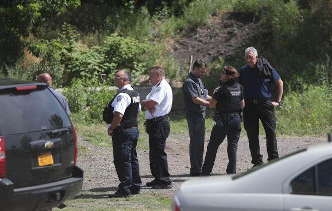 Buffalo police on the scene where the body of a black male was found in the Buffalo River at the South Park bridge. (Sharon Cantillon/Buffalo News)