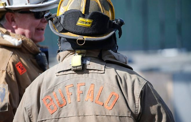 Buffalo firefighters battle a blaze in April 2016.  (Derek Gee/News file photo)