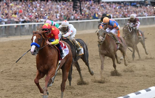 Justify captures the Triple Crown at Belmont Park. Photo Credit: NYRA/Chelsea Durand