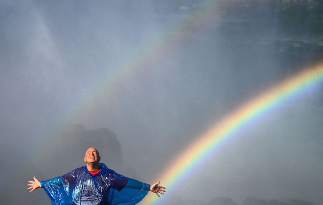 Mickey Osterreicher, last summer, after surgery for brain cancer, below the observation deck on the American side of Niagara Falls. (Cathaleen Curtiss/The Buffalo News)