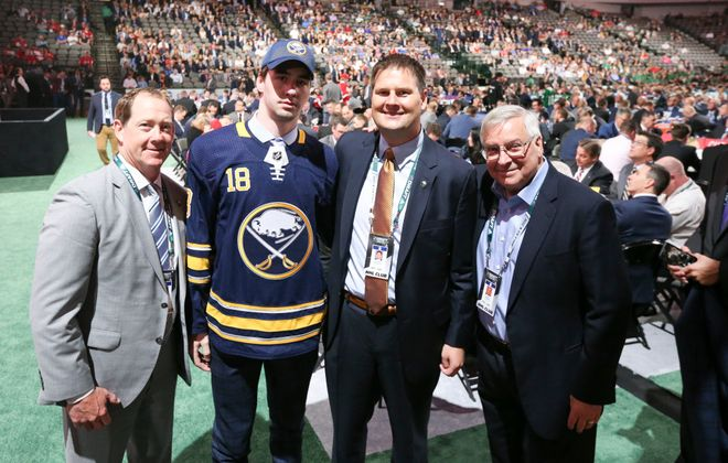 Sabres' second round draft pick Mattias Samuelsson, with Sabres Coach Phil Housley, general manager Jason Botterill and team owner Terry Pegula at the American Airlines Center in Dallas Saturday. (James P. McCoy/Buffalo News)