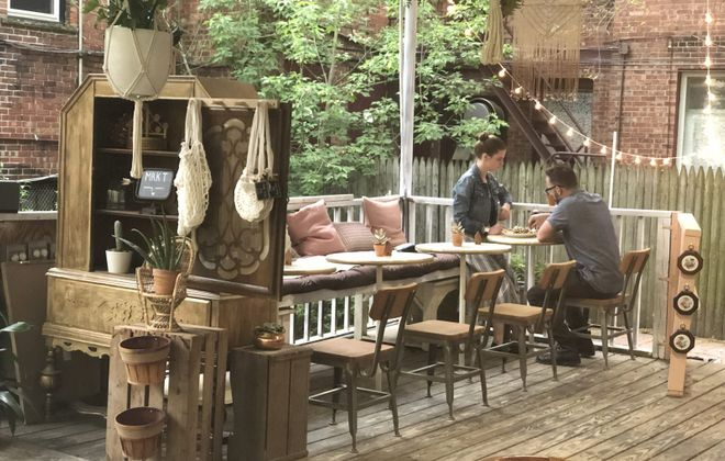 Root and Bloom's decor improves the already lovely atmosphere in the gazebo behind 423 Elmwood Ave. (Samantha Christmann/Buffalo News)