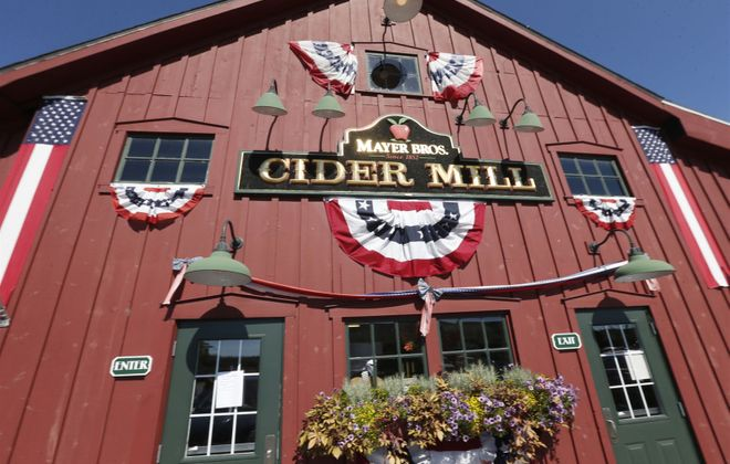 The main building of Mayer Brothers Cider Mill & Bakery, which housed the original 1852 cider press that let generations of families have jugs filled with fresh apple cider. It has been converted to the Mayer Brothers Cider Mill and Bakery store that still delights customers today.(Robert Kirkham/Buffalo News)