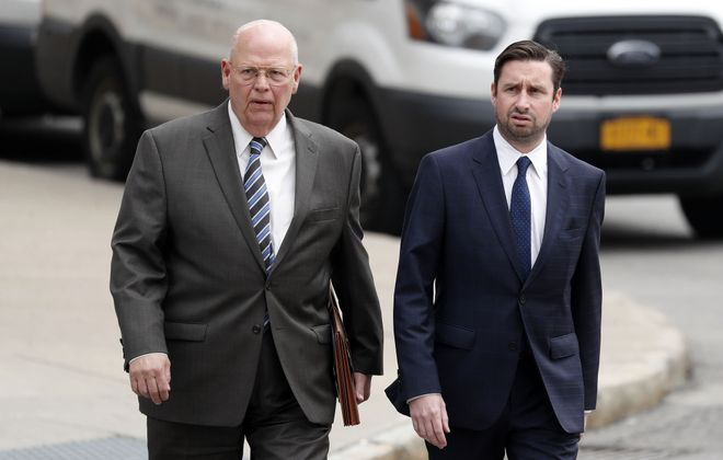 Patrick Ogiony, right, enters federal court in Buffalo with his attorney Joseph LaTona during an appearance in May.   (Mark Mulville/News file photo)
