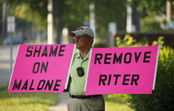 """Robert Hoatson of West Orange, N.J. protests outside of St. Elizabeth Ann Seton Catholic Church in Dunkirk before on July 1. The Rev. Dennis Riter was exonerated of claims of abuse and returned to his post as pastor after an investigation by the diocese found the claims """"were not substantiated."""" (Derek Gee/Buffalo News)"""
