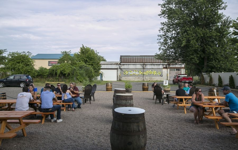 A look at the side beer garden of Flying Bison Brewing, one of a few different outdoor spaces at the Buffalo brewery. (Shuran Huang/Buffalo News)