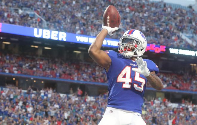 Marcus Murphy celebrates a touchdown in the second quarter of the first preseason game against Carolina. (James P. McCoy/Buffalo News)