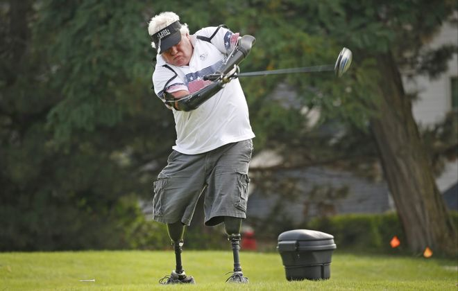 Jim Hunt, a quadruple amputee, competes in the 9th Annual Buffalo Amputee Golf Classic at Brierwood Country Club in Hamburg on Monday, Aug. 6, 2018.  (Robert Kirkham/Buffalo News)