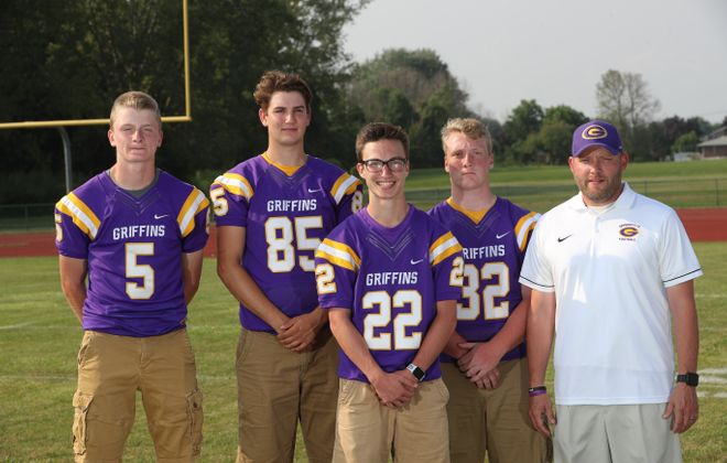 Springville Griffith players Nick Emmick (5), Alex Francisco, (85) Topher Elkins (22) Sean Barry (32), and coach Rob Valenti (John Hickey/Buffalo News)