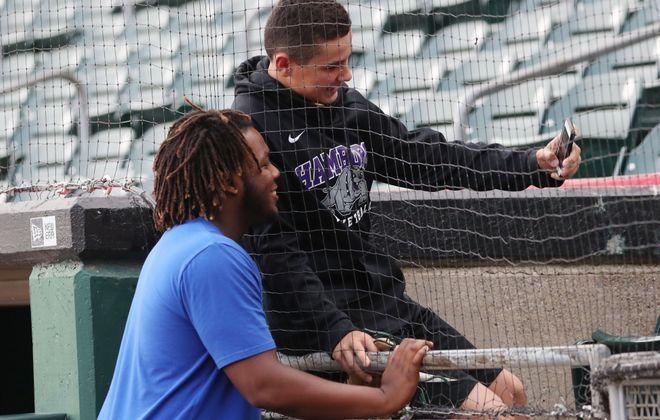 Nolan Smith, 13, of Hamburg gets a selfie with Bisons' Vlad Guerrero before the game. (Sharon Cantillon/Buffalo News)