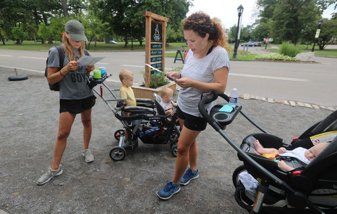 Patrons Sara Komosinski, left, and her sons Camden 2, and Liam, 2 months old, look over a menu with Liz Greis and her son Tanner at Ashker's in the Park. (John Hickey/Buffalo News)