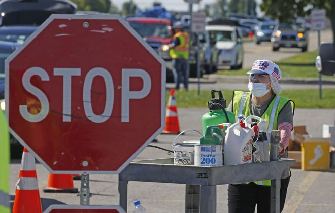 Worker Theresa Quiros inventories liquids taken from a person's car during a household hazardous waste drop-off Aug. 22, 2018, at Erie Community College North Campus. A similar event is on tap for Oct. 6 in North Tonawanda. (Robert Kirkham/Buffalo News)