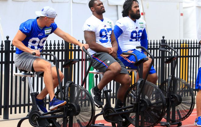 Injured Bills players Brandon Reilly, Marquavius Lewis and Star Lotulelei work out on the sideline during Sunday's practice at St. John Fisher College. (Harry Scull Jr./Buffalo News)