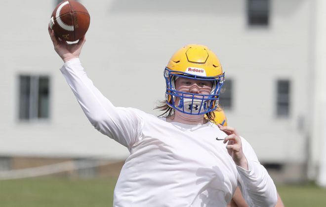 Liam Scheuer makes a throw during West Seneca West's first official practice of the season Monday. (Mark Mulville/Buffalo News)