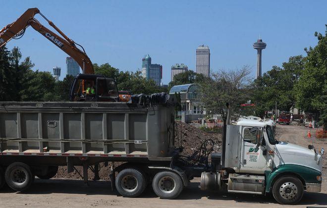 Crews began the process of hauling away dirt that contains radioactive waste on Thursday at Niagara Falls State Park. (John Hickey/Buffalo News)