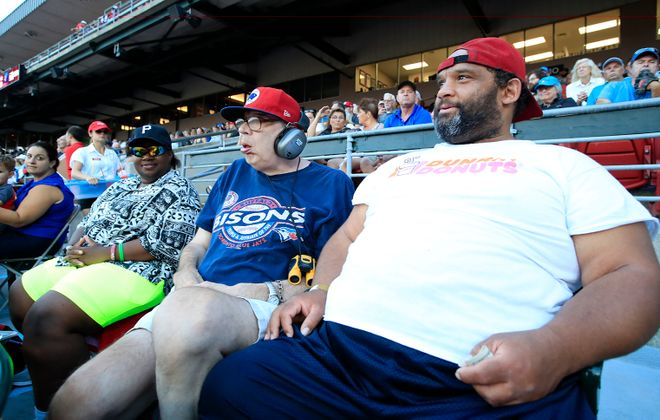 Old friends and regulars were there Monday for the  Bisons home finale:. From left to right, Deirdra Denise-Kelly, Stuart Boeckel and Sean Simms take in the game from row W, section 110, where they always sit. (Harry Scull Jr./Buffalo News)