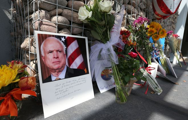 Items and personal notes  left outside the office of Sen. John McCain earlier this week in Phoenix. (Getty Images)
