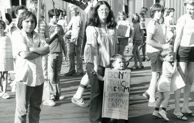 """An undated protest photo shows a child wearing a sign bearing the words, """"Don't Touch Me: I'm Contaminated by Love Canal."""" (News file photo)"""