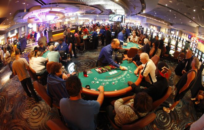 Gaming tables at the Seneca Buffalo Creek Casino pictured in August 2013. (News file photo)