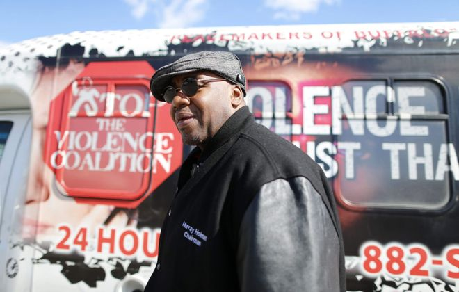 Murray Holman, executive director of the Stop the Violence Coalition, is seen at the corner of East Delavan Avenue and Grider Street where he and volunteers from the Peacemakers try to keep things calm as area schools let out for the day in this 2015 photo. (Derek Gee/News file photo)